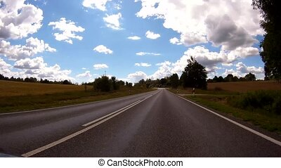 Driving a Car on a Country Road - POV - Point of view front - windshield.