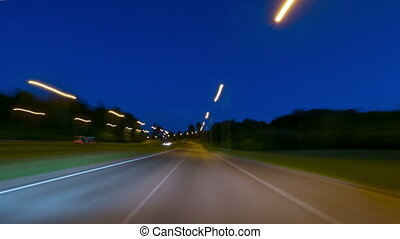 Driving a car on night city, time-lapse