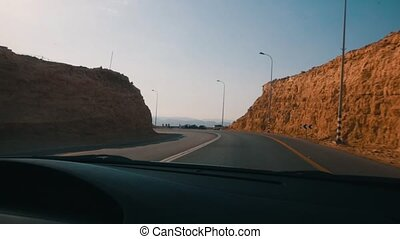 Driving a car on Red Rock Canyon Road in the Red Rock Canyon...