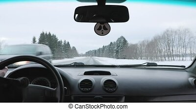 driving a car on winter road inside view