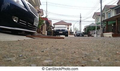 Driving a lowered car on a sloping car park - Bangkok -...