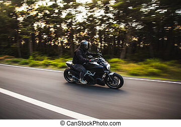 Driving a motorcycle in the forest road