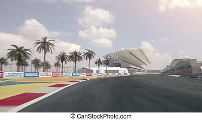 Driving along a formula one race track across finish line