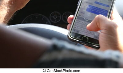 Driving and texting - Shot of Driving and texting