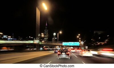 Driving at Full Speed to Downtown Chicago at Night Camera...