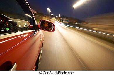 Driving at Night - A man driving a car at night on a...