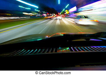 Driving at night - Blurred street lights produced from a ...