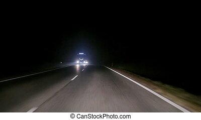 Driving at night - Driving in on a road at night