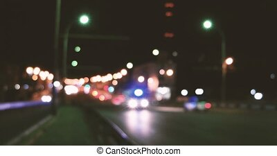 Driving at night. Hyper lapse Illuminated blurred cars city traffic on town streets.