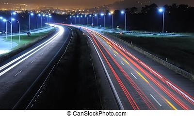 Driving at night. - Intense traffic.