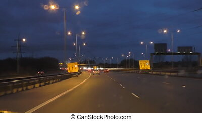Driving a car at night on motorway in England, GB. Roadworks, speed restriction, driver view.