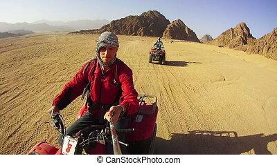 Driving ATVs in the Desert of Egypt