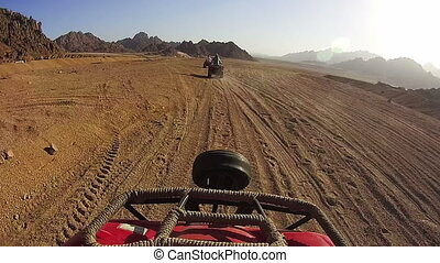 Driving ATVs in the Desert of Egypt
