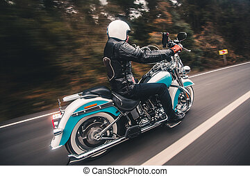 Driving blue motorcycle on the highway
