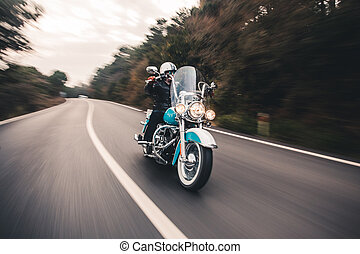 Driving blue motorcycle on the road. front view
