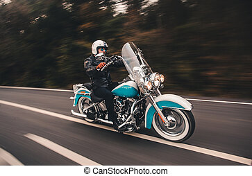Driving blue motorcycle on the road