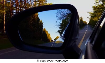 Driving Bumpy Rural Road View of Side Mirror in Daytime....