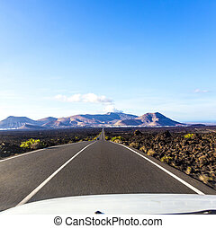 driving by car in the Timanfaya volcanic national park i