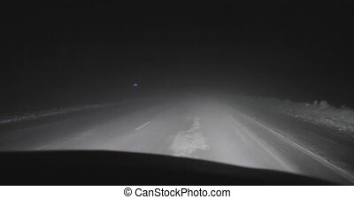 driving by car on the night roads at winter front view