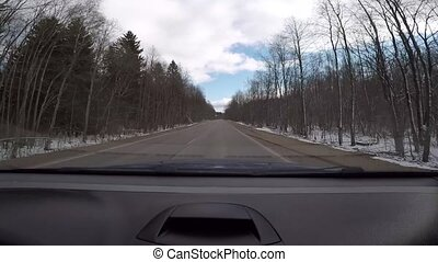 Driving by car on the spring roads