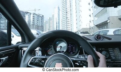 Driving car in the city first person view.