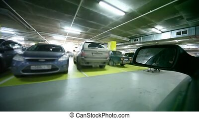 driving car in underground car park, view from side window