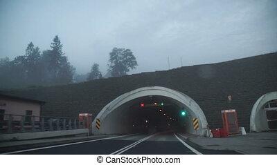 Driving car on coastal road through the tunnel