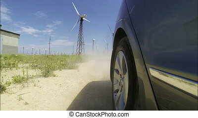 driving car on dusty road - Driving car on dusty road...