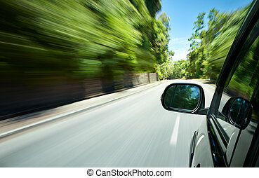 driving - car speeding on a straight road