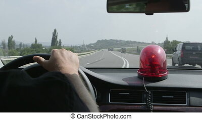 Driving car with red flashing light
