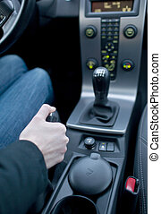 driving concept - young female driver using handbrake