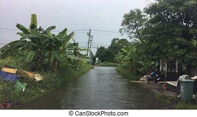 Driving flooding road in bangkok, thailand