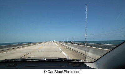 Driving. Florida Keys causeway. - Driving on a causeway in...