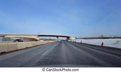 Driving Highway With Roadside Snow in Day. Driver Point of...