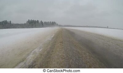 driving in a car on a country road in winter. slow-motion...