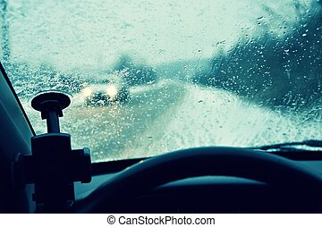 Driving in bad snowy weather and cars in the fog. Bad winter weather and dangerous automobile traffic on the road. Light vehicles in fog.