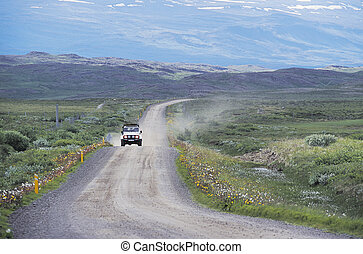Driving in Iceland - A four wheel drive vehicle drives...