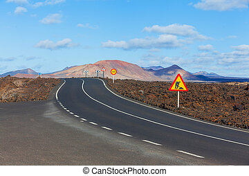Driving in Lanzarote with view to Timanfaya volcanoes, Canary, Spain. Panorama