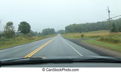 Driving in misty Muskoka. Fields.