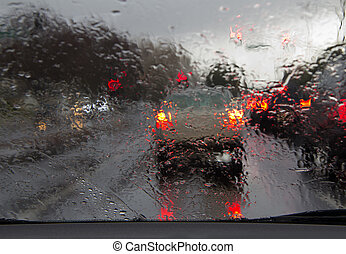 Driving in rain - Road view through car window with rain...