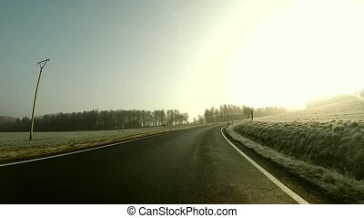 Driving in the Morning on a Country Road