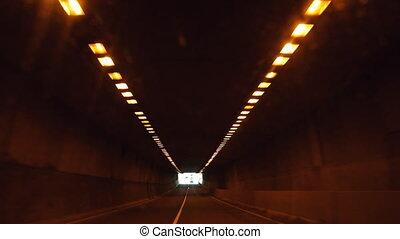 Driving in tunnel. - Driving through a tunnel with lights...