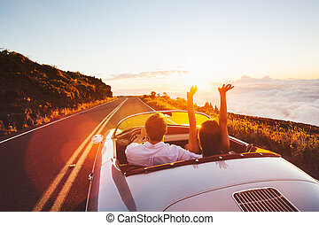 Driving into the Sunset - Happy Couple Driving on Country...
