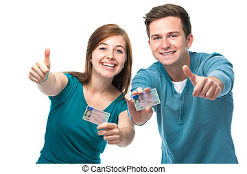 driving license - happy teens showing their driving license