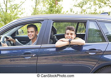 driving man and children in the car window