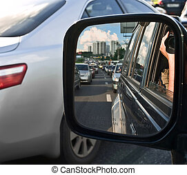 Driving mirror - shooting into the rear-view mirror