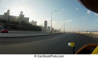 Driving motorbike in a city at the evening