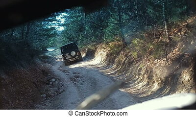 Driving off-road car in Crimea. Stabilized camera follows a jeep climbing up a mountain. Extreme auto tourism.