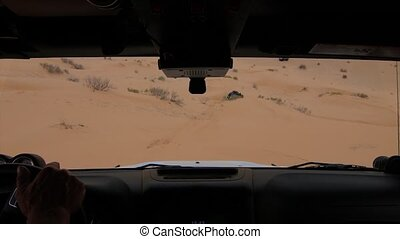 driving off-road car in the sahara