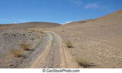 driving on a dirt road in the Altai mountains